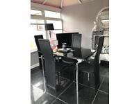 Extendable black glass dinning table and 6 chairs