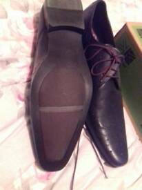 BRAND New black leather with burgundy laces size 11