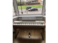 Electric digital piano with weighted keys and sustain pedal
