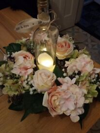 Wedding flowers and candle table arrangements