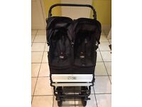 Double mountain buggy. Good condition. Comes with bumper bar, cup holder, storm cover.