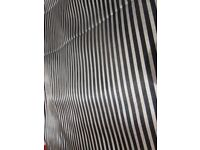 8m of stunning black and gold striped satin fabric