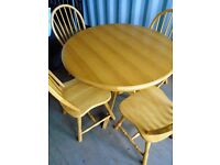 SOLID PINE ROUND TABLE & 4 MATCHING CHAIRS FOR SALE.