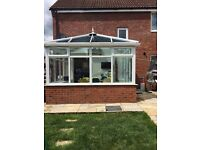 4 year old Edwardian conservatory with self cleaning blue tint glass roof.