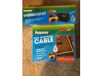 Soil warming cable and thermostat