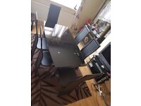Black tempered glass dining tables and chairs