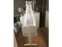 White swinging crib with 10 piece bedding