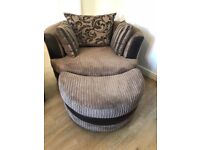 Practically brand new 360 degree swivel circular armchair with matching foot stool