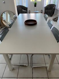 Large white table and 6 chairs