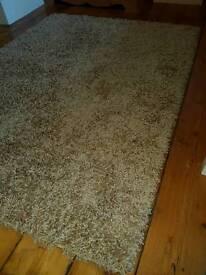 Beige shaggy rug