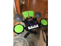 Children's play drum kit and keyboard.