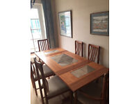 Dining table and 6 chairs, plus matching coffee table