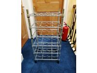 Stainless steel wine rack with adjustable shelves, takes 24 bottles of wine.