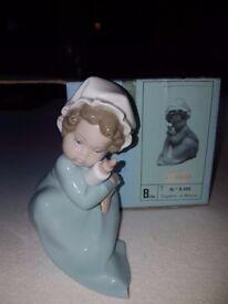 Retired Lladro - Baby holding Bottle
