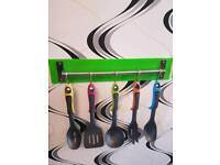 Multicoloured kitchen utensil set with choice of coloured backing