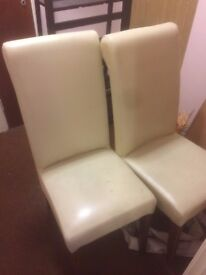 Two Cream Leather Chairs