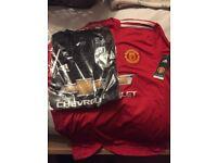 Man Utd home and away kit