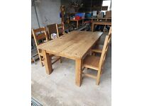 Large plank wood dining table with 4 solid wood chairs