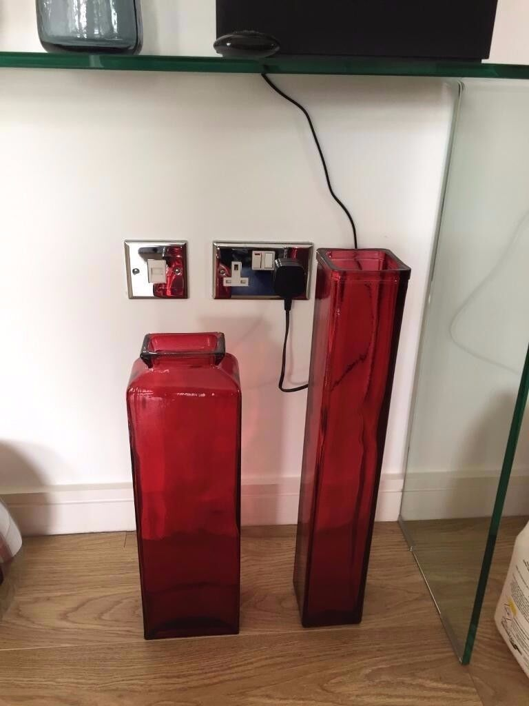 Two large red designer vase. Excellent condition