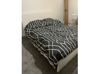 King size bed frame. Brand new in box