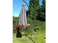 Large grey tilting patio parasol