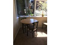 Round dining folding table and three chairs