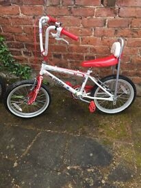 Three children's bikes, small infant bike, muddy fox and a one direction bike. Also a small scooter