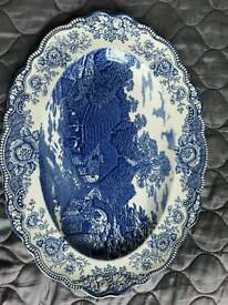 Blue and white oval plate with hanger