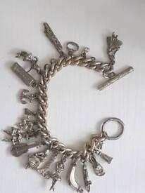 Antique white metal charm bracelet
