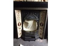 cast iron inset for fireplace with front grate