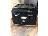 Black Delonghi 4 slice toaster. Fully working. RPP £45