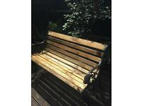 Rustic garden bench with lion head armrest