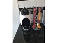 Dolce Gusto coffee pod machine with rotating coffee pod holder and several pods