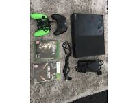 Xbox 1 with 2 controllers and 2 games