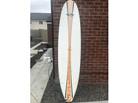 Bic Minimal Surfboard 7'9 with Alder Board Bag with Ripcurl LS Summer wetsuit.