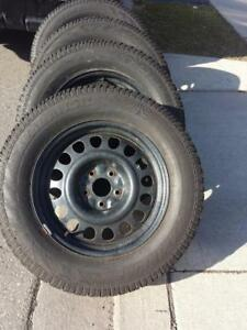 LIKE BRAND NEW  JEEP GRAND CHEROKEE HIGH PERFORMANCE HERCULES WINTER TIRES 265 / 60 / 18 ON STEEL RIMS