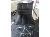 Black swivel salon chair
