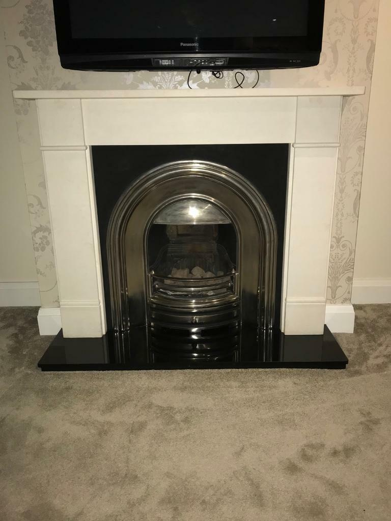 Gas fire, black hearth and white surround