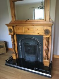 Pine fireplace with mirror and fender