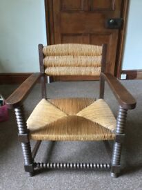 Low Breton oak frame and rush seat chair in excellent condition