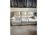 Cream leather sofology 3 seater and 2 seater both are double recliners only 12 months old