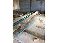 Six large timber joists. 4 at 14 foot x 9 inches x 2 inches, plus 2 at 14 foot x 9 inches x 3 inches