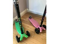 2 Maxi Micro Scooter's (green & pink) - £30 each £55 the pair