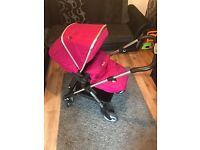 SILVER CROSS WAYFARER PUSHCHAIR IN RASPBERRY. COMES WITH CAR SEAT, RAIN COVER AND CHANGING BAG.