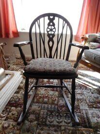 Rocking chair in dark wood