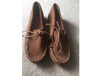 Brown suede moccasin shoes