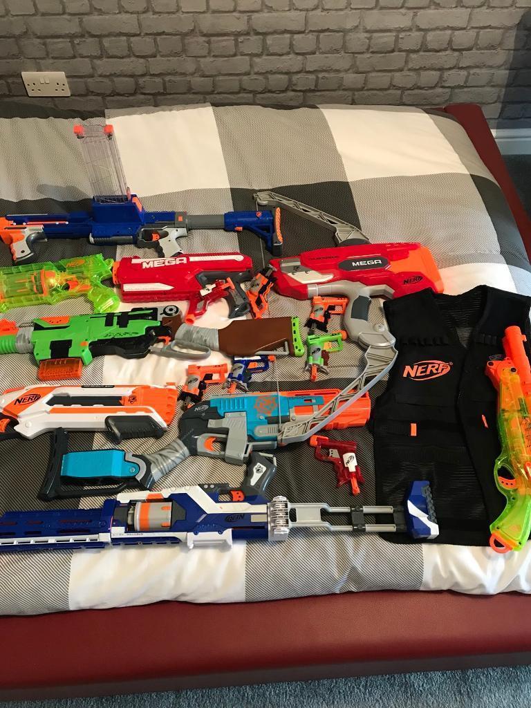 9 nerf guns plus 7 mini jolts and a nerf vest for sale