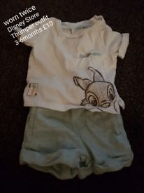 Selection of baby clothes and other items