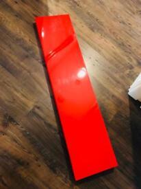 Ikea 'Lack' red gloss floating shelf.