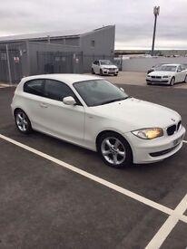 BMW 116I Sport, 3 door hatchback, white.